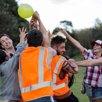 Funny Outdoor Team Building Challenge High-Vis Smiling