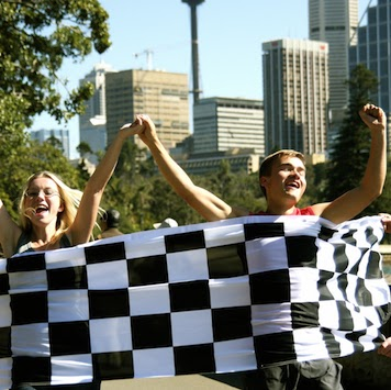 Classic Amazing Race Winners Crossing Finish Line Chequered Flag Sydney