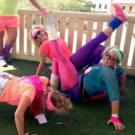 Lycra Retro Girls Team Stretching Before Amazing Race With Bars