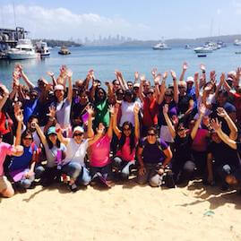 Corporate Team Building Beach Amazing Race Hands in the air